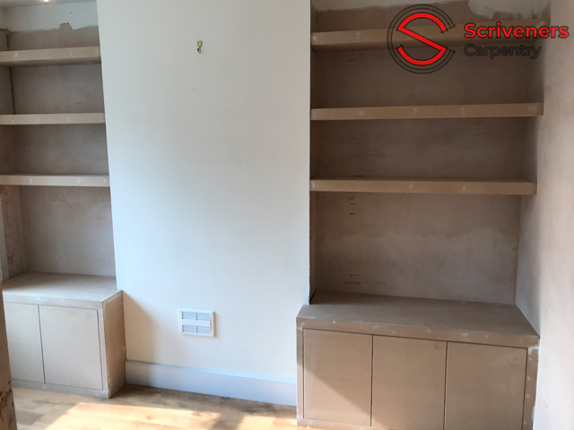 photo showing two alcoves with cabinet and shelves