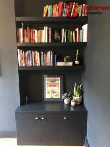 Photo of Alcove cabinet and floating shelves