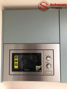 Photo of newly installed kitchen with highlevel microwave
