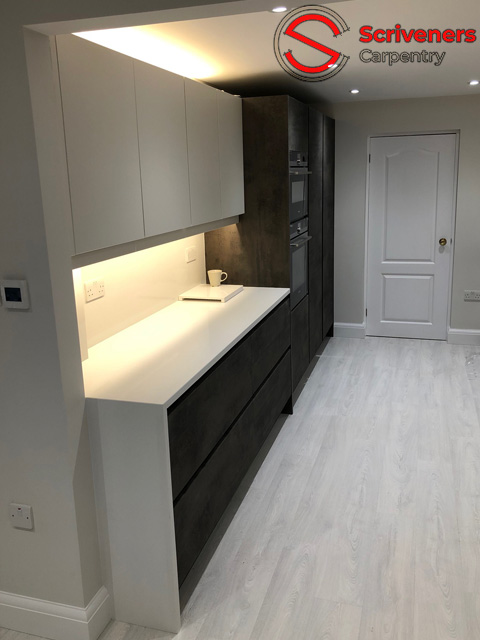 photograph showing new kitchen with unit lighting